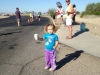 Gracie volunteering to hand out water