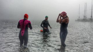 Chilly Elk Lake putting on swim cap